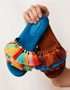 Add a bright pop of color to your look with these fun slide-on featuring bold, multi-color tassel details on the top of the foot. Shoe Makeover, Bohemian Shoes, Vetement Fashion, Cute Sandals, Slide Sandals, Shoes Sandals, Fabric Jewelry, Blue Satin, Jeffrey Campbell