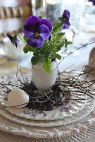 Pansy in Egg Planter, Willow Nests (though moss, Spanish, or Green, could also be used, as well as Grape Vines)