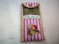 Pretty case to keep your glasses safe, the case is handmade from cotton fabric, lace and ribbon and I have appliqued a flower motif on to it, the case is lightly padded and held closed by velcro. The case measures 9 x 19 cm. Postage is free. Gift Wrapping Services, Glasses Case, Free Gifts, Ladder Decor, Cotton Fabric, Applique, Cats, Pretty, Flowers