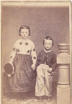 1860's - sorry mama, but that trim on the little gal's dress is just awful...I KNOW, it was in vogue
