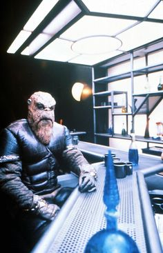 Morn - from Star Trek: DS9...always at the bar...and his name is Norm backwards.