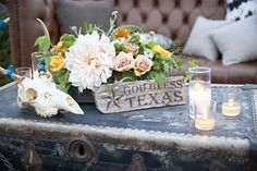 Before I Do Events texan going away party, florals, votives, leather, distressed wood, orange, peach, chest, god bless texas, http://beforeidoevents.com/ http://sweetmariedesigns.com/