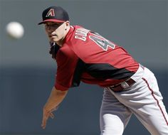 Arizona Diamondbacks starting pitcher Patrick Corbin throws to the Colorado Rockies during the first inning of an exhibition spring training baseball game on Sunday, Feb. 24, 2013 in Scottsdale. Ariz. (AP Photo/Marcio Jose Sanchez)