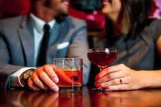 For the fun and modern couple, taking engagment photos with beverages is a cute idea