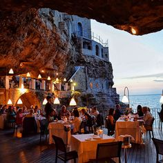 From a deep-sea escape to a cavern carved into the side of a cliff, these are some of the most dazzling places to eat in the world.