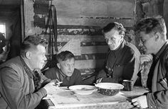 Soviet commissars of 1st Guards Division eating a meal near the front, 28 Nov 1942