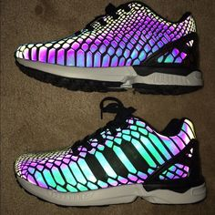 Adidas ZX Flux Black/Reflective shoes With camera flash, they have reflective feature. Incredible shoes. Never been worn. Fit Women's 8-9\Men's 7 black with white sole. Adidas Shoes Athletic Shoes