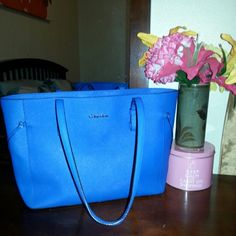 Calvin klein purse! Royal blue! Used only a few times... perfect condition! Like new.... medium size almost large Calvin Klein Bags