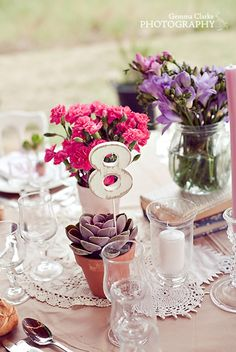 Wedding table numbers in succulent flowers.