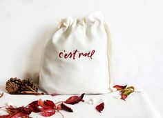 CHRISTMAS HAND EMBROIDERED DRAWSTRING BAG  This white linen pouch is the perfect way to offer gifts for Christmas. It is hand embroidered and made from white thick linen with a rustic look. You can use it to fill with your gifts and also it's a great way to have a zero-waste bag. Christmas Gift Bags, Embroidered Bag, Zero Waste, Bag Storage, Hand Embroidery, Fill, Christmas Decorations, Pouch, Rustic