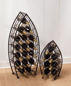 """Metal Boat Bottle Racks - Set of 2 by Accent Your Life. $188.49. Unique home accents. Small: 10.5""""W x 6.25""""D x 19.5""""H; Large: 15""""W x 8""""D s 34""""H. Set of 2. Small rack holds 7 bottles; Large rack holds 17 bottles. Metal. These metal boats add a sculptural accent to the room as well as a perfect place to store and showcase your favorite wines. Whether used at a beach house, a lake house, or just in a home that loves all things nautical, they evoke the spirit of the..."""
