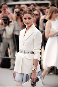 Olivia Palermo wears a belted blazer with a crystal embellished blazer.