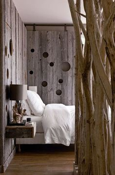 Do this just behind bed, with lighting that shines through cut outs. Modern rustic!!