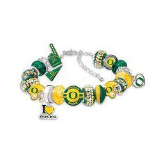 University of Oregon Ducks Football Fan Crystal Charm Bracelet With 18... (130 CAD) ❤ liked on Polyvore featuring jewelry, bracelets, charm bracelet jewelry, bracelet bead charms, beads & charms, bracelet charms and adjustable bangle