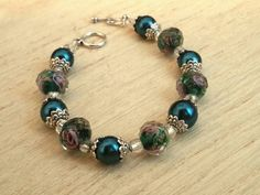 Check out this item in my Etsy shop https://www.etsy.com/listing/236435750/peackock-blue-beaded-bracelet