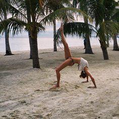 When practicing my #oneleggedwheelpose in the Philippines!🌴 #yoga #travel #beachyoga #yogachallenge #yogapose
