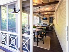 When it comes to porches, this back-of-the-house fixture is a superior example of the form as designed by The Porch Company . With its stained, tongue and groove cypress flooring, overhead fans and lighting scheme, entertainment center and fireplace (at the far end), it is the ultimate hang-out spot of the house.