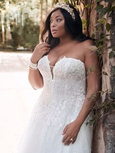 "Life gets exceptionally complicated when you're engaged. Opt for ""simply magic"" with this sparkly tulle ball gown wedding dress in embroidered lace and a gorgeous silhouette. Beaded lace motifs over tulle Sheer organza lined lace bodice Deep illusion sweetheart neckline Covered button over zipper closure Available in plus size"