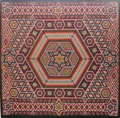 amazing antique hexagons quilt in the Victoria & Albert Museum