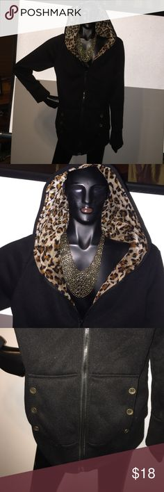 Hooded black with leopard inside Great hooded sweatshirt with big pockets. So soft and comply. New without tags Tops Sweatshirts & Hoodies