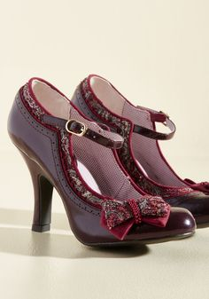 <p>Just like your favorite jeans and staple tees, these burgundy heels by Ruby Shoo are a major win for your wardrobe - only with a lot more flavor! Glossy, deep purple uppers, scalloped accents, and tapestry-style trimmings give stunning detail to these bow-topped pumps, making them as unique as they are irresistible.</p>