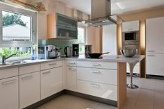 white kitchen cabinets with horizontal long silver hardware - Google Search