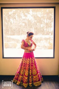 Sabyasachi lehenga , pink sabyasachi lehenga , contrast jewellery , bride getting ready , pink bridal lehenga , velvet bridal lehenga , pink and gold