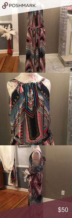 Tolani silk dress Maxi dress. Multi color and print. Belt ties at waist.  Pockets on each side. V in front.  Slit on one side.  Adjustable toe in back.  Picture 4 is the back. Never worn. Tolani Dresses Maxi