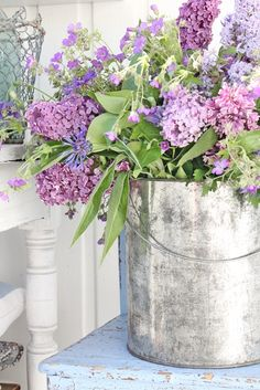 Add color to your outdoor living space this #spring with a shabby chic arrangement of #flowers. We love this collection of #lilacs!