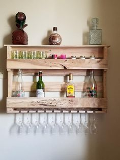 Handcrafted wood wine rack made from 100% recycled pallets. At Emiles Wood Creations we make every item by hand in our shop. We pay attention to every detail before our wood creations go out to the customer to ensure customer satisfaction. This item can be stained for the customer before shipping. Wine Storage, Small Storage, Kitchen Storage, Smart Kitchen, Storage Room, Diy Kitchen, Storage Baskets, Kitchen Ideas, Wine Rack Plans