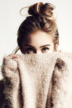 Photo via: Yves Huy Truong Nothing like a good top knot and a cozy knit. Loving her hair color...