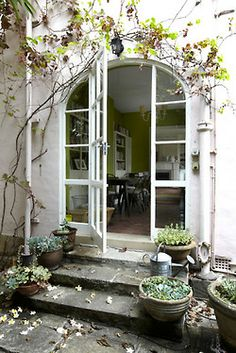 Arched door entrance with white exterior and potted plants design Decorating at Home with Pink Interior Exterior, Exterior Design, Exterior Doors, Rustic Exterior, Beautiful Space, Beautiful Homes, Casa Patio, Entrance Doors, Arch Doorway