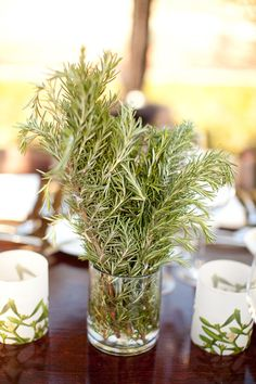 Floral Arrangements-I love the idea of using rosemary! I love the smell
