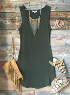 The Fun in the SunTank Dress in Oliveis comfy, fitted, and oh so fabulous! A great basic that can be dressed up or down! Sizing: Small: 0-3 Medium: 5-7 Large: