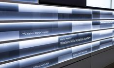 """Fabricator Ad-Ex International created the look of individual donor """"tiles"""" by digitally printing a fritted-glass effect in alternating colors across the acrylic strips. Donor names were second-surface etched on the 3/8-inch acrylic."""