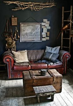 Leather couch, wood chest, dark walls