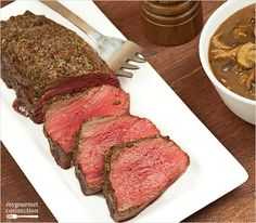This beef tenderloin roast is coated with a simple blend of salt, pepper and garlic and served with a chunk sauce made with mushrooms and port wine.