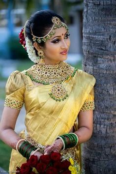 South Indian Bride in stunning green and gold set looks beautiful with her yellow sari. South Indian Wedding Saree, Indian Bridal Wear, South Indian Bride, Saree Wedding, Wedding Blouses, Kerala Bride, India Wedding, Hindu Bride, Bridal Sarees