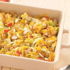 Acorn Cabbage Bake Recipe -I have served this variation of squash often. It's a nice side dish, especially appropriate in the fall— or it can be used for a main luncheon dish. If you prepare your squash ahead and freeze it, it takes very little time to put this recipe together.