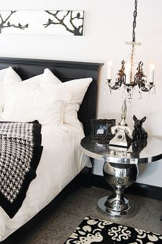 Black And White Bedroom with mirror, & chandelier