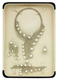A CULTURED PEARL AND DIAMOND PARURE, BY ELIE CHATILA