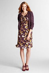 I own and wore this dresss with a plain plum sweater, light brown belt and light brown suede pumps