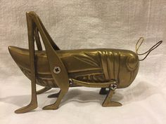 A personal favorite from my Etsy shop https://www.etsy.com/listing/255278772/vintage-brass-hearth-cricket-grasshopper
