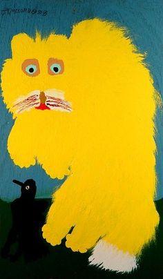 furry yellow cat and little black bird. Jake McCord