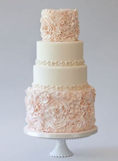 LOVE the Ruffle Rose details on the bottom and top tiers of this four tier wedding cake! Probably White Cream or Ivory colored for me.Source From LOVE the Ruffle Rose details of this four tier wedding cake.