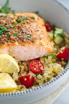 Mediterranean spiced salmon and vegetable quinoa recipe is a healthy protein packed meal! Earthy spices, roasted lemons and fresh vegetables in each bite. Mediterranean Salmon, Mediterranean Spices, Mediterranean Diet Recipes, Clean Eating, Healthy Eating, Healthy Food, Fish Recipes, Seafood Recipes, Kale Recipes