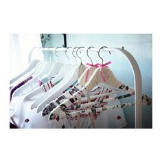 BUMERANG Curved clothes hanger IKEA  Excellent idea to wrap fabric around hanger to help make clothes stay put!