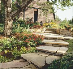 WALKWAYS and GARDEN PATHS: Natural stone works well in this rustic setting