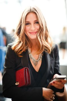 Olivia Palermo's classic blazer, red clutch and crystal -tastic wreath