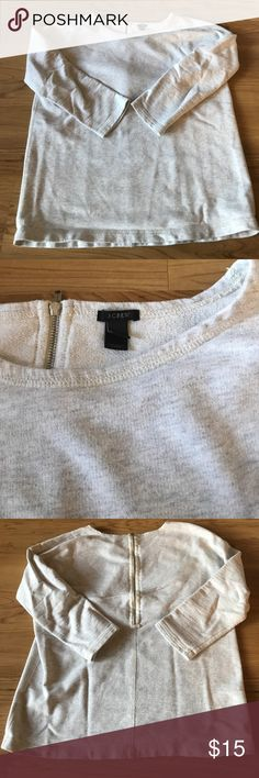 """J.Crew Lightweight Scoop Neck Sweatshirt sz S EUC J.Crew lightweight heather gray/oatmeal sweatshirt size Small. Cute zip back detail with a scoop neck & 3/4 sleeves. Perfect for workout wear or a summer night in the beach! Material: Cotton Measurements approx: 19"""" bust & 24"""" long. 🖤 Bundle & Save with my other listings! 10% discount on 2 or more items in my closet 🖤 J. Crew Tops Sweatshirts & Hoodies"""